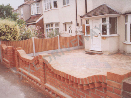 Block Paved Front, New Wall And Block Paving To Rear Garden.